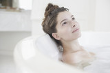 Woman relaxing in bubble bath