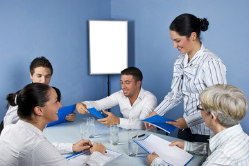 Group of business people in middle of meeting