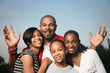 Happy African American family, father with teenage daughters. - 16165750