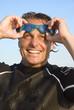a color portrait of a handsome smiling triathlete.