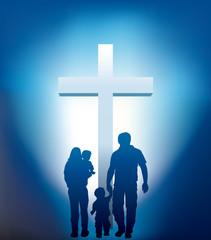 christian family walking towards a cross