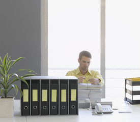 Businessman organizing paperwork