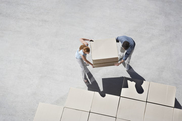 Couple organizing boxes