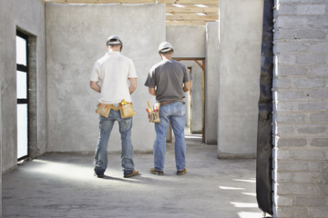 Construction workers inside unfinished home