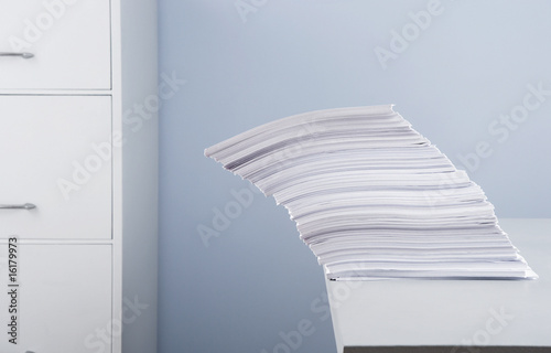 Stack of paperwork tipping over