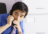Businessman whispering into telephone