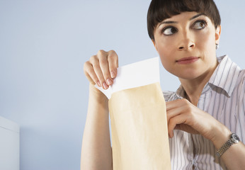 Businesswoman peaking at confidential documents