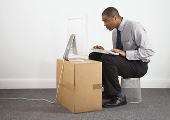 Businessman working on makeshift desk