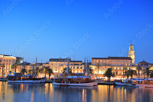 Split harbour depicting Diocletian's palace, by night