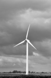 Wind turbine in cloudy skies black and white