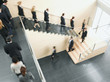 Businesspeople walking down office staircase