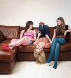 Teenage girls hanging out in living room
