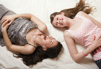 Girls laughing on bed
