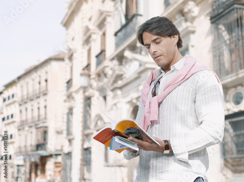Man reading guidebook