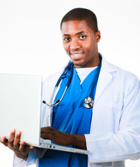 Handsome doctor working on a laptop