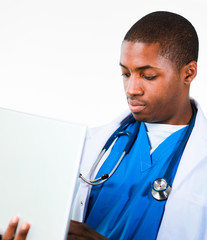 Young African doctor working on a laptop