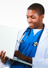 Friendly Afro-American doctor working on a laptop