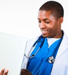 Close-up of an friendly Afro-American doctor working on a laptop