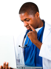Thoughtful doctor working with a computer