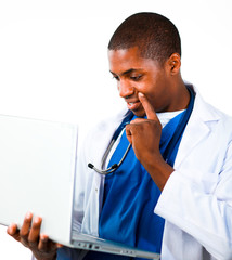 Close-up of an Thoughtful doctor working with a computer
