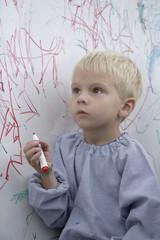 Boy scribbling on whiteboard