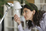 Woman changing lightbulb