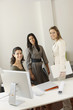 Businesswomen posing in office