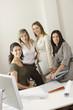 Businesswomen posing in office