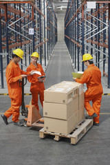 Workers loading boxes in warehouse