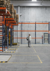 Businessman walking in warehouse