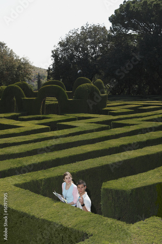 Young couple lost in hedge maze