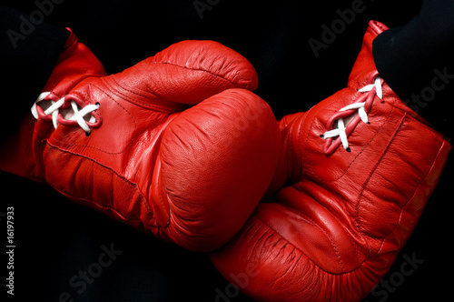 Lace tied boxing gloves