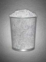 Wastebasket full of shredded paper