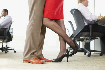 Businesspeople hugging in office