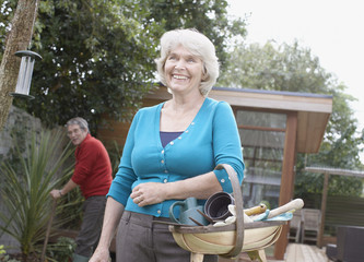 Senior woman holding gardening basket