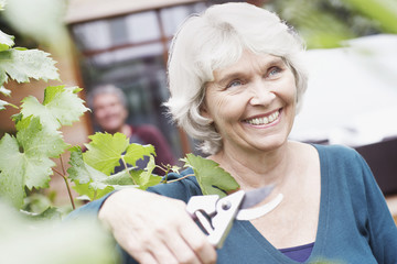 Senior woman holding gardening clippers