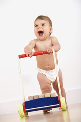 Baby walking with push cart