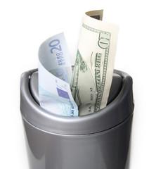 Money in trash bin