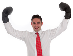 successful businessman with boxing gloves held triumphantly