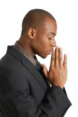 Business man praying with eyes closed