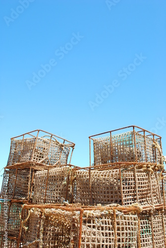 Old fishing cages in the port of Cascais, Portugal