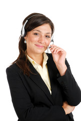 Communcations business woman holding her headset