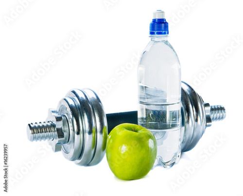 Bottle of mineral water, dumbbells  and green apple
