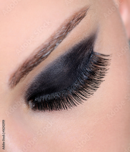 female eye with bright glamour make-up