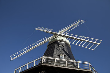 Windmill towards blue sky