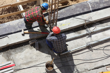 two construction workers on a building project
