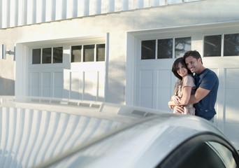 Couple admiring new car