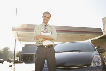 Insurance adjuster inspecting car