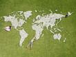 Children making world map made of rocks