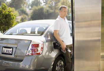 Man filling car at gas station